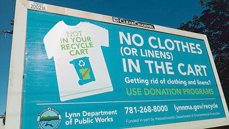 "Photo of the ""Not In Your Recycle Cart"" billboard."